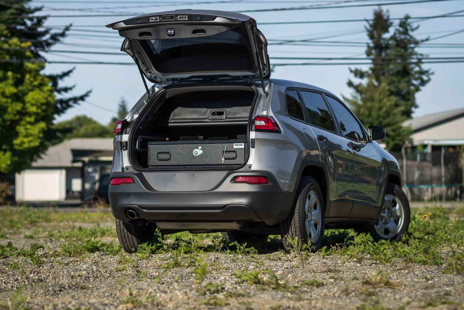 A Jeep Cherokee with a TruckVault Secure Storage System in the trunk.
