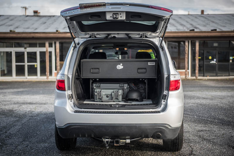A silver Dodge Durango with a TruckVault in the cargo space for secure storage.