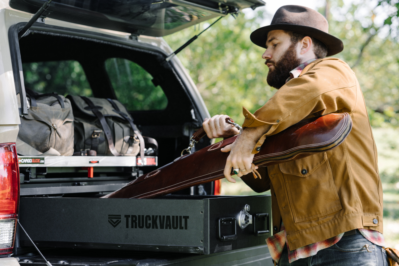 A man putting his firearm into his TruckVault.