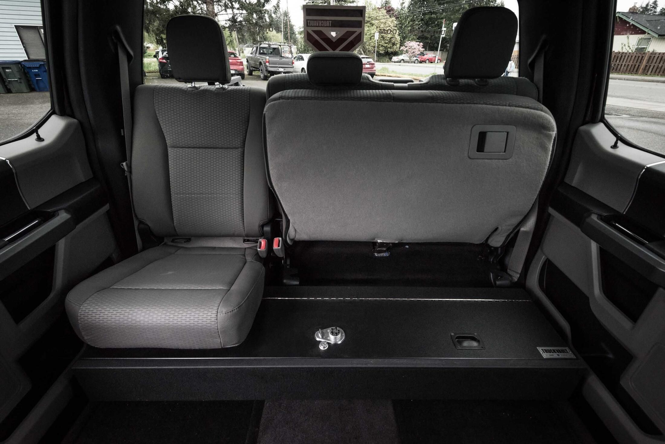 A Ford F-150 SeatVault with half the back row seat folded up.