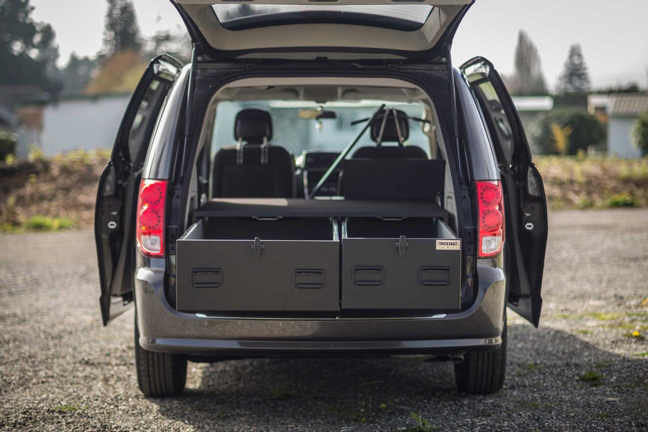 The back of a black Dodge Caravan with a magnum height TruckVault