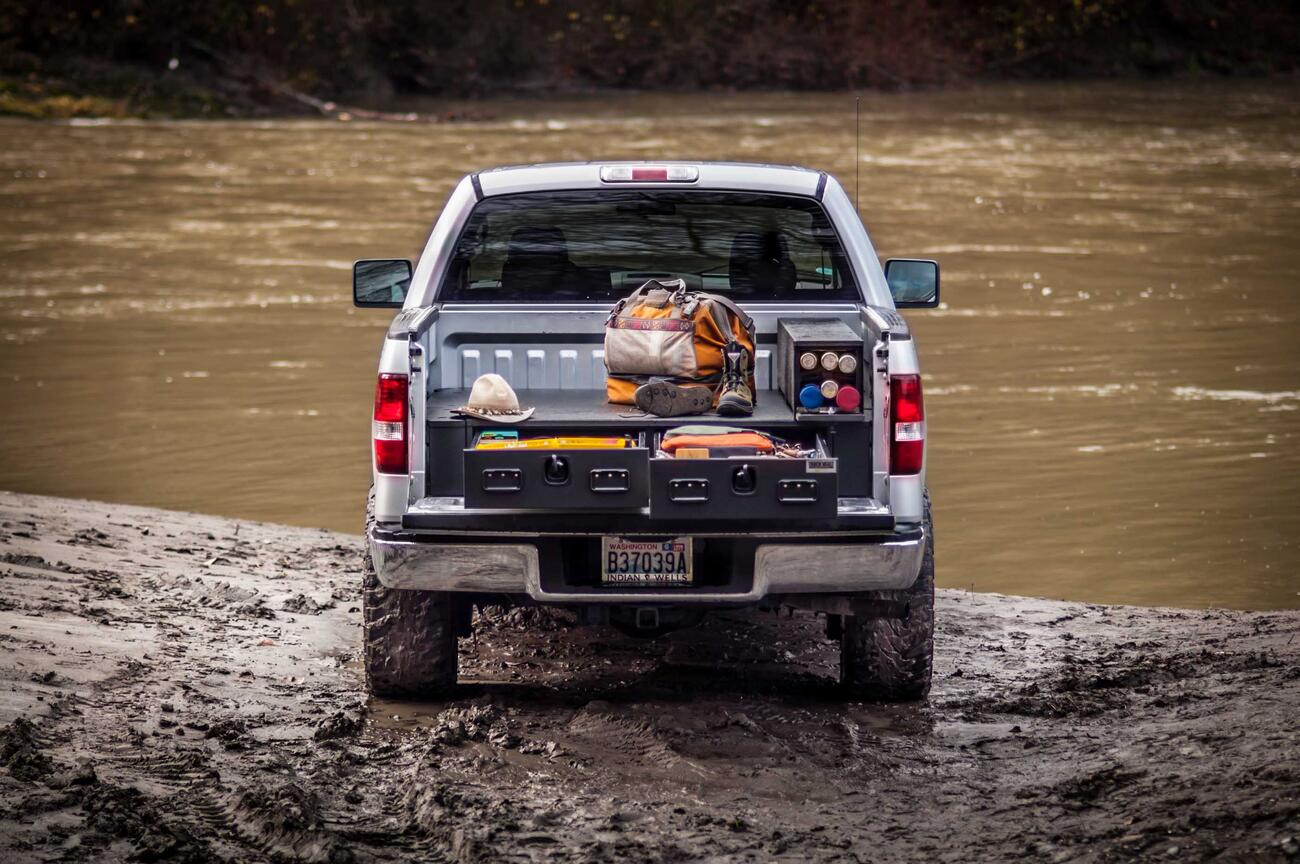 A Silver Ford F-150 All-Weather TruckVault filled with fishing gear.