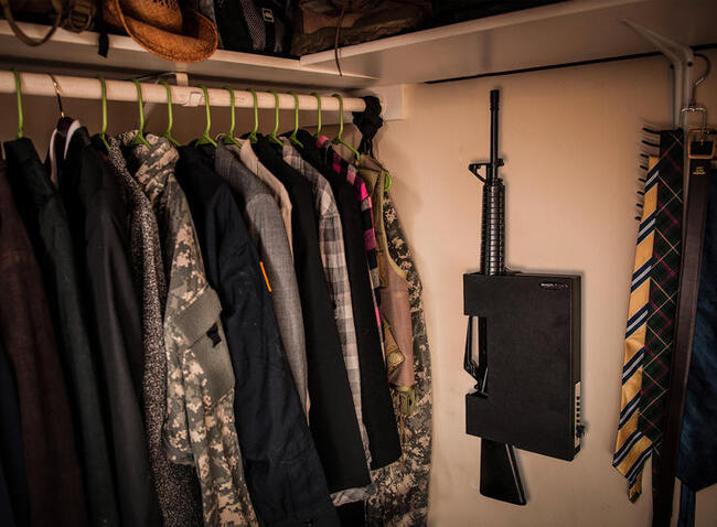 A ShotLock with an AR secured in the closet of a home.