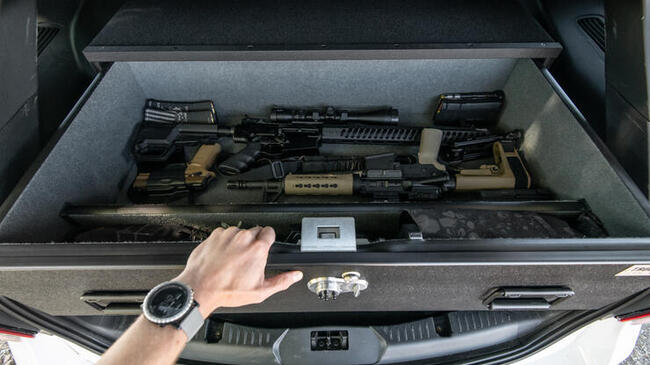 A TruckVault with various firearms in it.