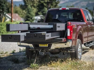 A Ford F250 with a custom 2 drawer TruckVault used for everyday gun storage.