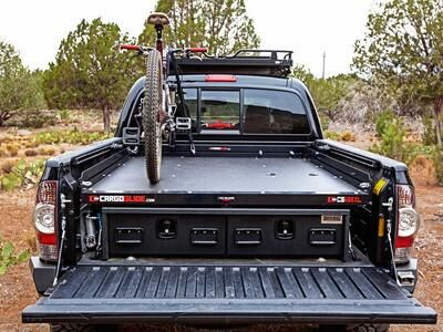A Toyota Tacoma with a TruckVault, Cargo Glide, and mountain bike.