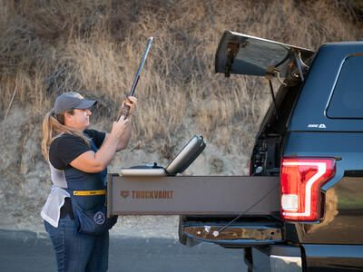 Olympian Kim Rhode loading her shotgun out of the back of a TruckVault.