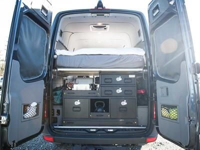 A TruckVault secure storage system in the back of a Mercedes Sprinter.