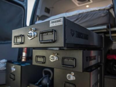A TruckVault secure storage system in the back of a Mercedes Sprinter van.