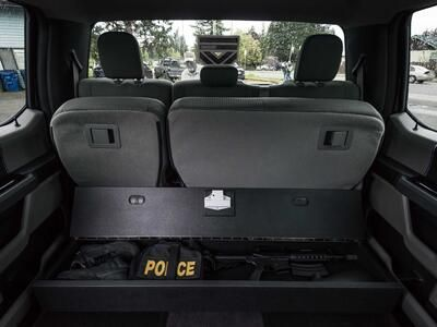 A SeatVault under the back seat of a Ford F150 used to store police gear.