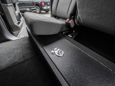 A SeatVault in the back of a Ford F150 with one seat folded down.
