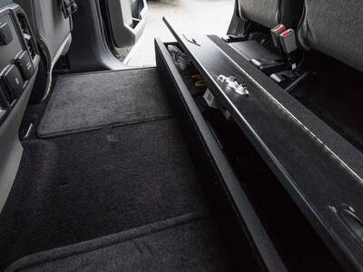 A picture of a SeatVault and the backseat carpet space in a Ford F150.