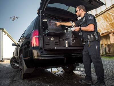 A police officer flying a drone using the built in screen in his TruckVault.