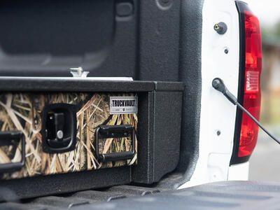 TruckVault All-Weather storage system with Mossy Oak drawer front.