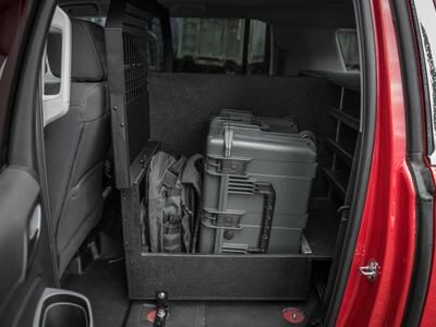 The Inside of a fire department Chevy Suburban with a custom TruckVault and Pelican case.
